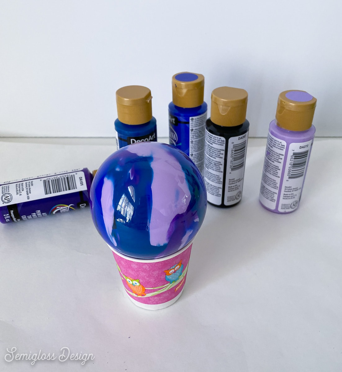 letting paint drain into paper cup