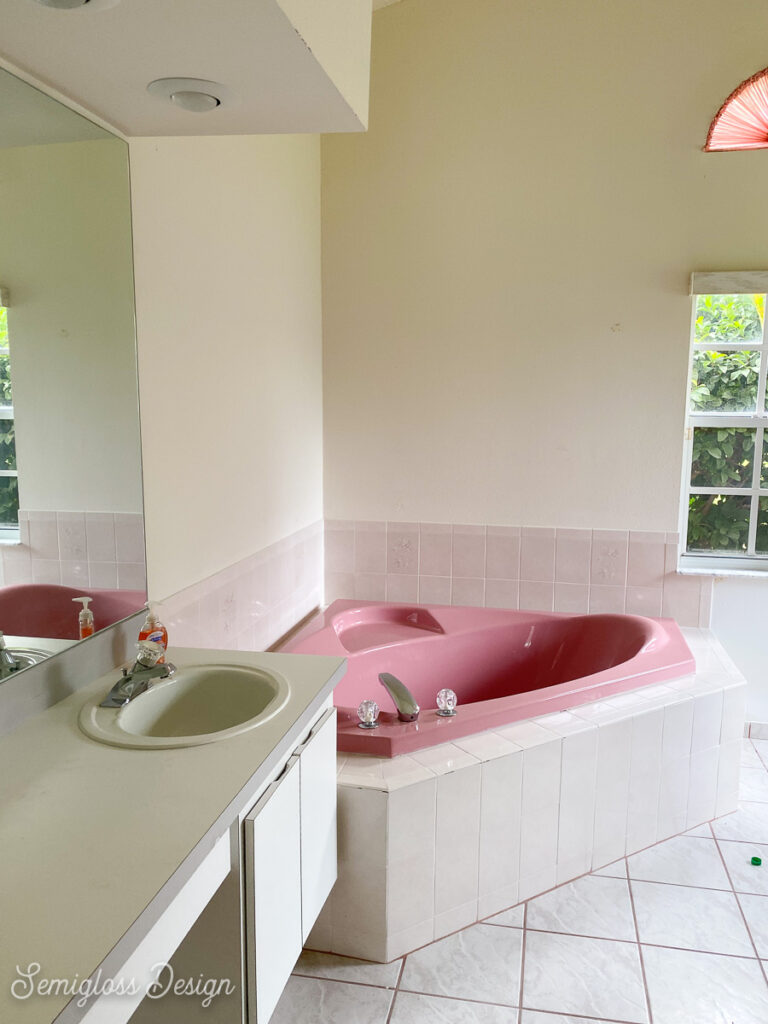 primary bathroom before with pink tub