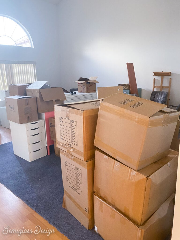 stacks of boxes in living room