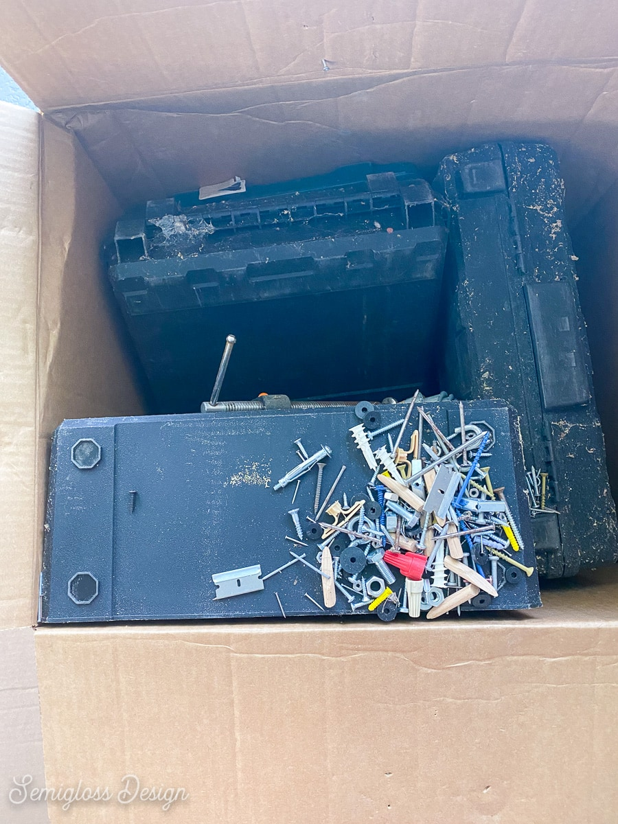 box with spilled nails and screws