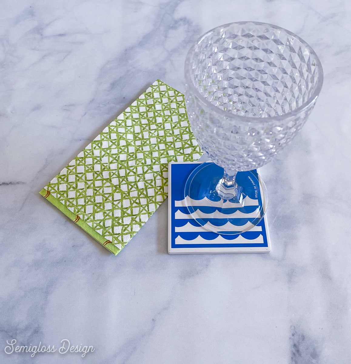 glass and coaster with blue waves