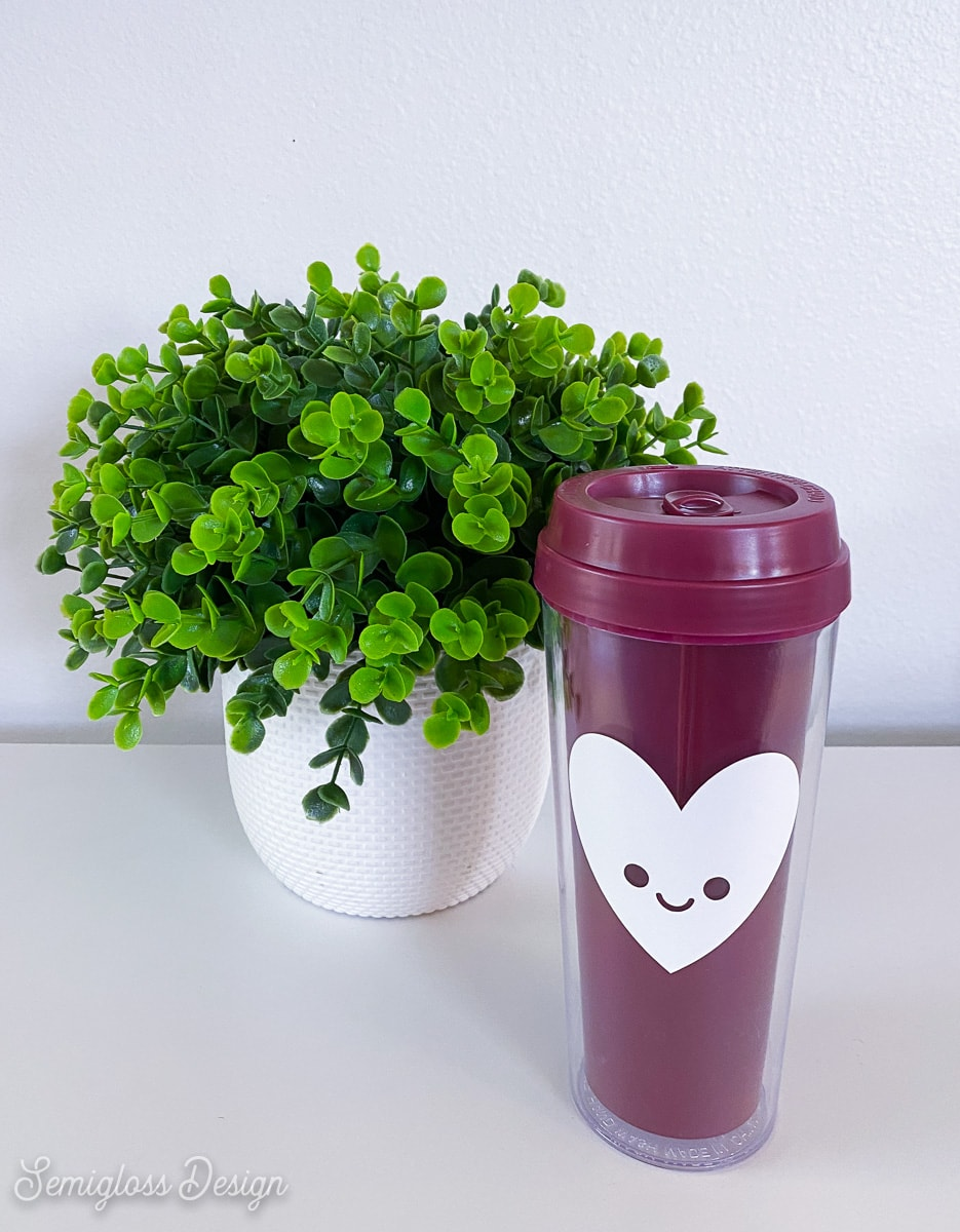 tumbler with happy heart by plant