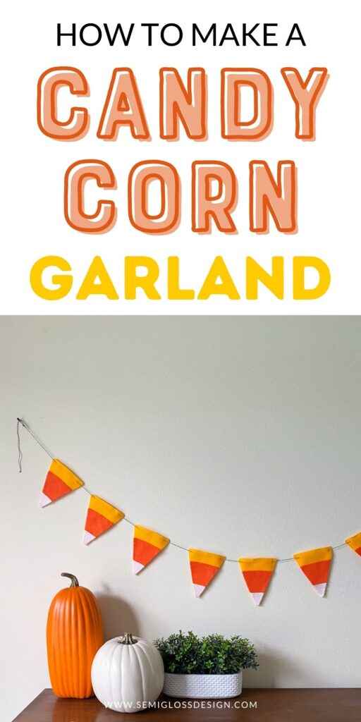 candy corn garland on wall with pumpkins on dresser