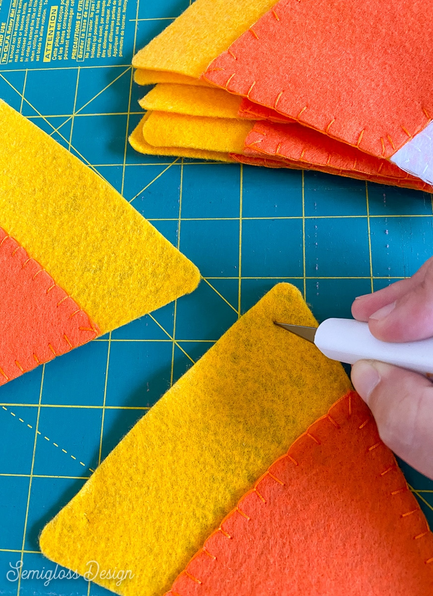 cutting slits for string in banner