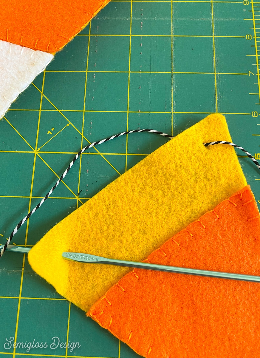 using crochet hook to thread string in banner
