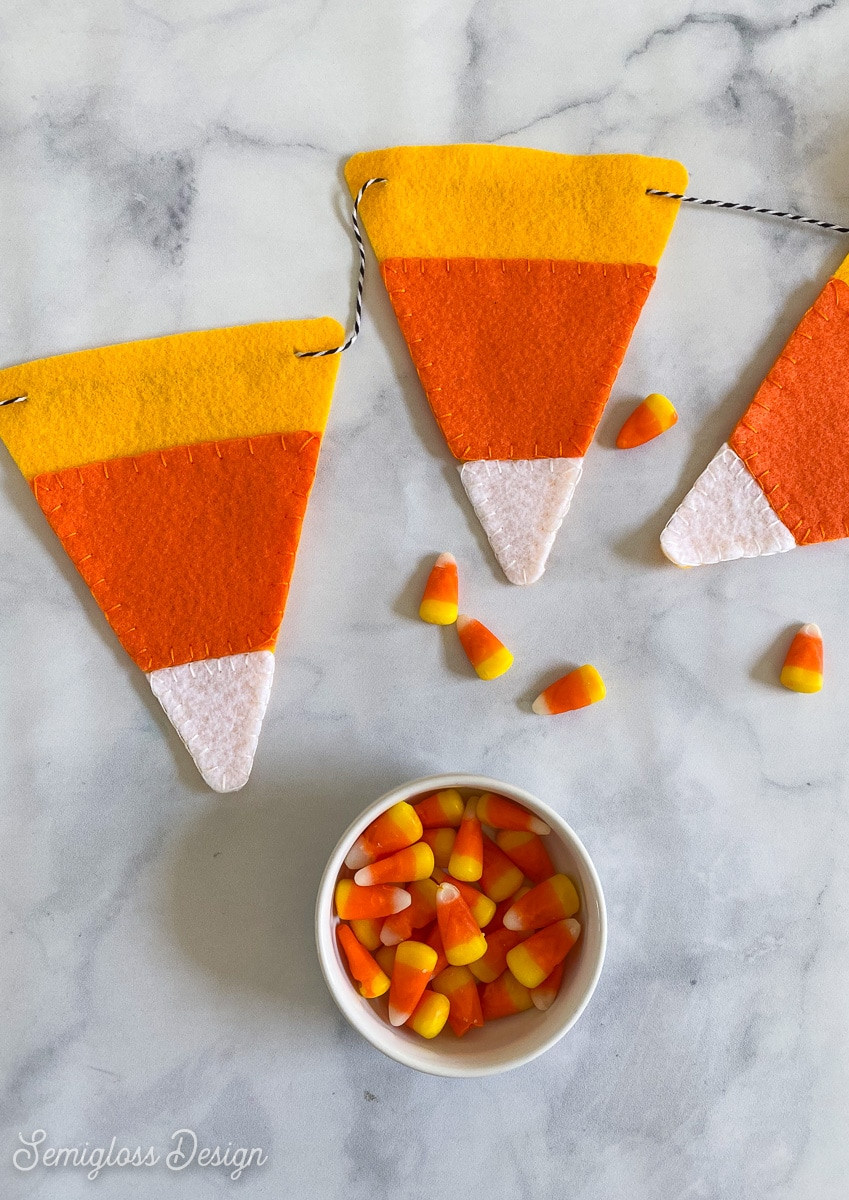 felt candy corn banner with bowl of candy