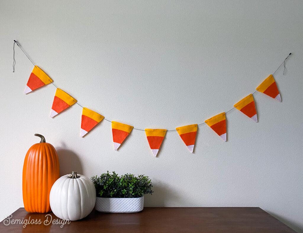 candy corn banner above dresser