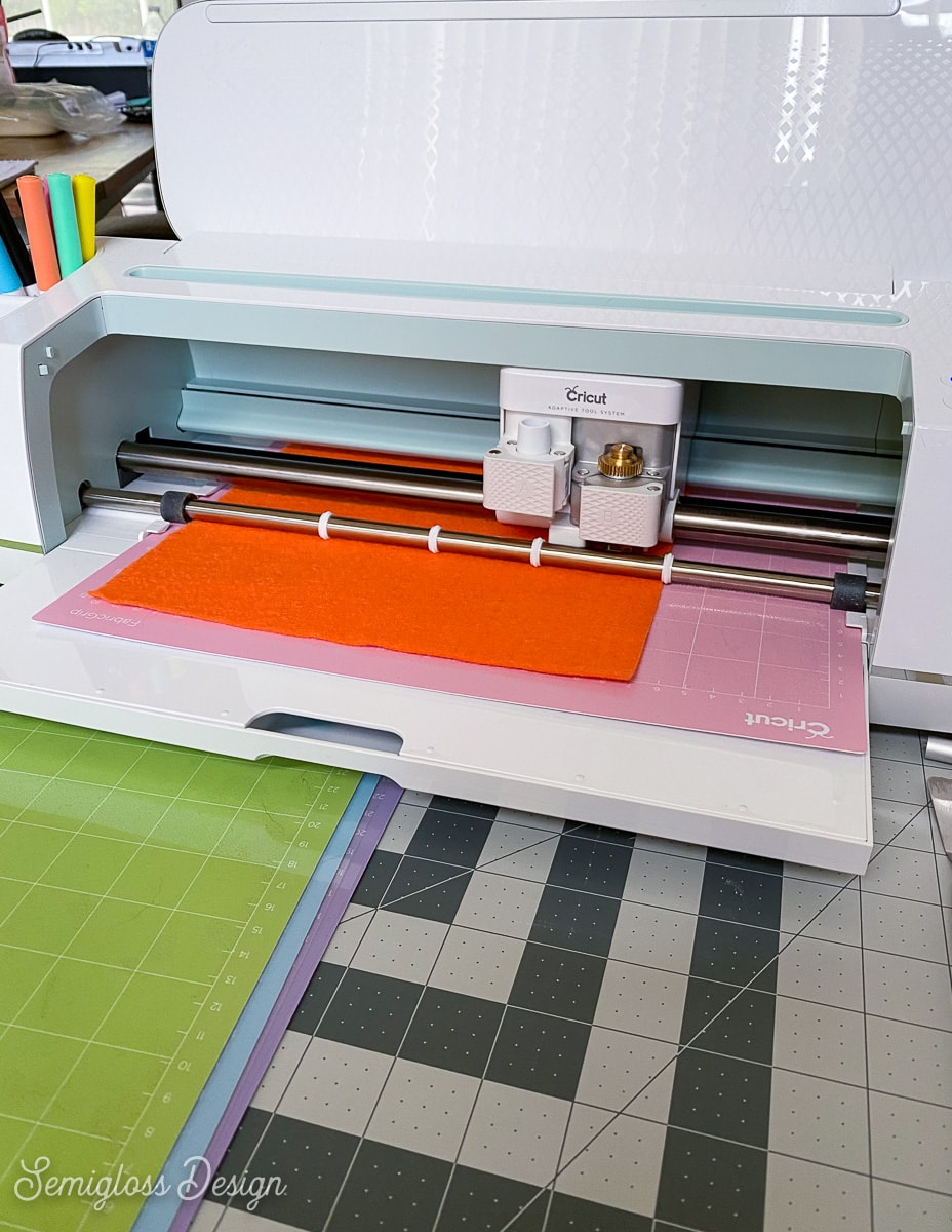 cricut maker cutting orange felt
