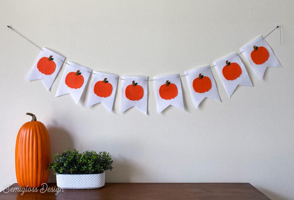 felt pumpkin banner hanging above dresser