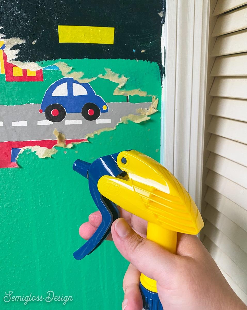 spraying wallpaper border